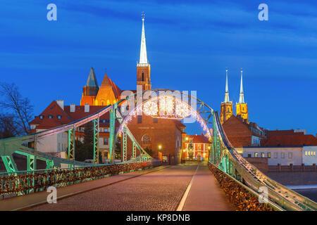 Tumski Bridge at night in Wroclaw, Poland - Stock Photo