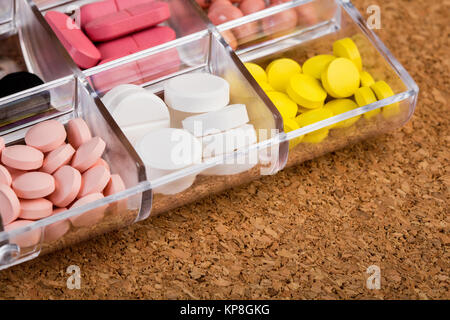 Various pills in plastic container - Stock Photo