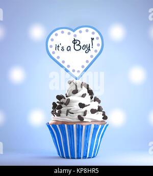 newborn baby boy card message on a delicious cupcake stock photo