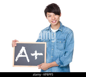 Man hold with blackboard showing A plus mark - Stock Photo