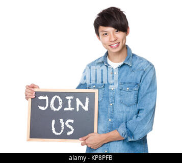 Man hold with blackboard showing a phrases of join us - Stock Photo