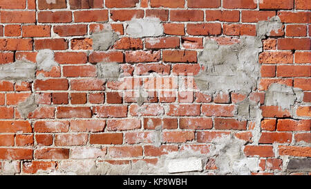 Poorly repaired and patched up Brick Wall - Stock Photo