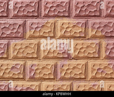 Textured decorative brick wall that has been painted in two different colors - Stock Photo