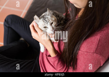 Asian Woman play with her kitten