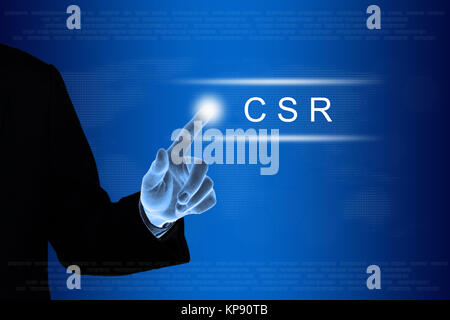 business hand clicking CSR or Corporate social responsibility button - Stock Photo
