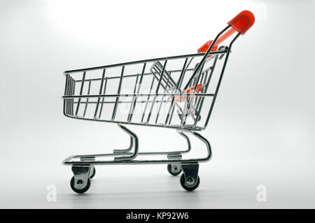 Empty shopping cart, side view, on white background - Stock Photo