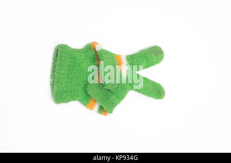 Knitted woolen gloves, winter gloves victory symbol - Stock Photo