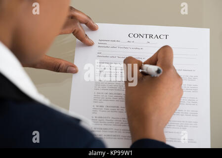 Businesswoman Filling Contract Form - Stock Photo