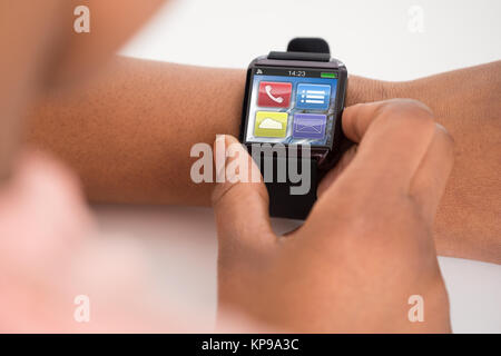 Person's Hand Wearing Smartwatch - Stock Photo