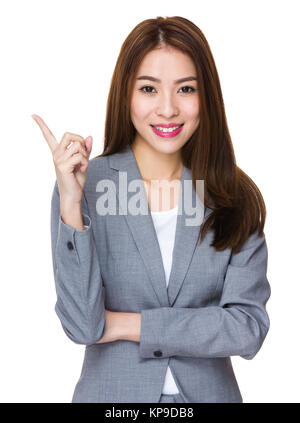 Businesswoman with finger pointing up - Stock Photo