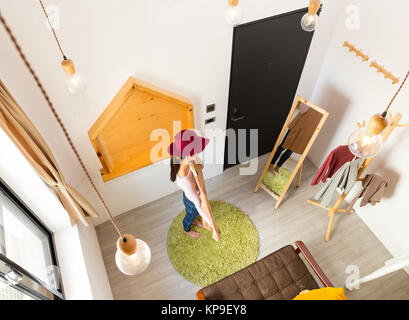 Asian Woman choosing the clothes before going out - Stock Photo