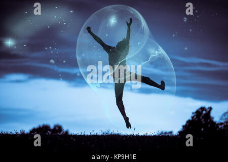 Silhouette Happy Boy Jumping Inside a Big Bubble - Stock Photo