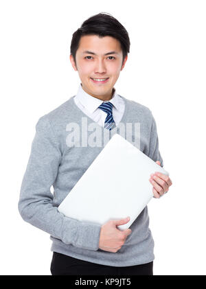 Businessman hold with notebook computer - Stock Photo