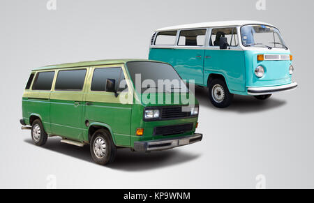 Two VW mini vans side view isolated on grey background - Stock Photo