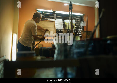 Sculptor Painter Artist Chiseling A Wooden Bas Relief-1 - Stock Photo