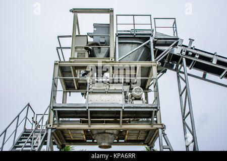 batching plant is a machine to create concrete, from sand, stone, cement and water - Stock Photo