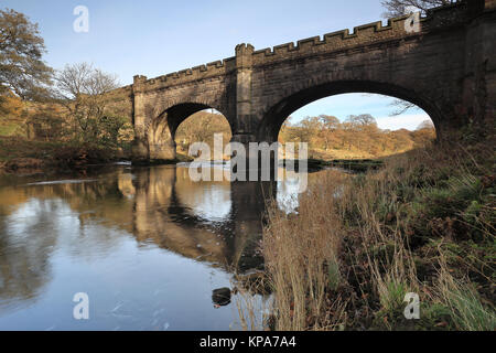 A bridge and aqueduct over the River Wharfe at Strid Wood, near to Bolton Abbey in the Yorkshire Dales National - Stock Photo