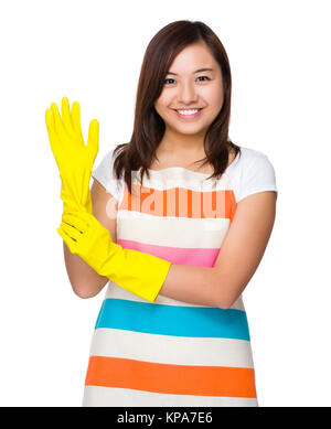 Young housewife wear with plastic gloves - Stock Photo