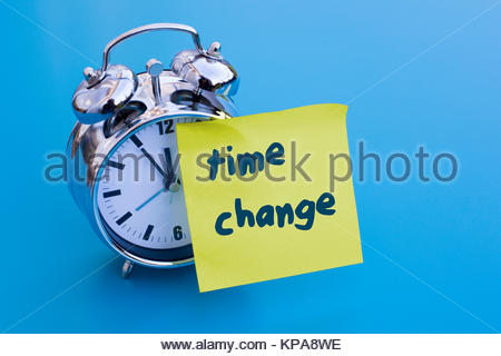 alarm clock with note 'time change' - Stock Photo