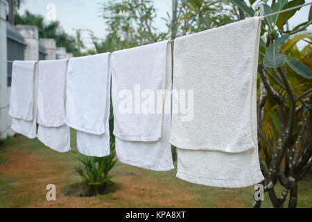 white towels hanging on the line - Stock Photo