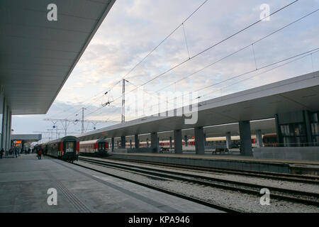 Passengers wait on the platform at the main train station. Sofia, Bulgaria - Stock Photo