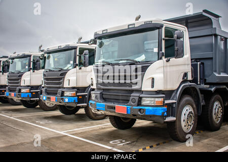 photo of brand new dump trucks, to use in construction site - Stock Photo