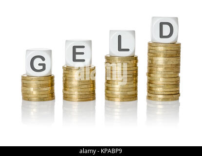 münzstapel lettered cubes - money - Stock Photo