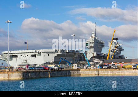 HMS Queen Elizabeth aircraft carrier seen from Portsmouth Historic Dockyard, Portsmouth, Hants UK in December - Stock Photo