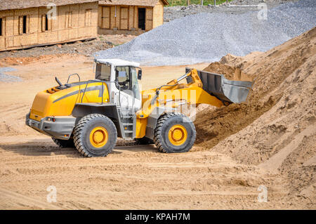 landscape photo of wheel loader in construction site - Stock Photo