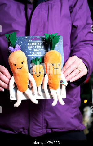 Bristol, UK. 14th Dec, 2017. Aldi's Carrot family plush toys went on sale in the UK today. Kevin and Katies offspring, Chantenay, Jasper and Baby Carrot were on the shelves first thing this morning. Queues formed outside Aldi stores before they opened and shoppers joined in store 'scrums' to try and get their hands on the latest additions to the popular TV Ad Carrot family. Credit: Stephen Hyde/Alamy Live News