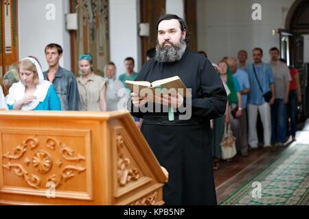 Belarus, Gomel city, St. Nicholas Monastery, a religious Orthodox holiday 'Palm Sunday' 18.06.2016 year. The priest - Stock Photo