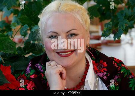 The woman in scarf.Russian woman. Beautiful Russian woman in a national shawl. Slavic woman - Stock Photo