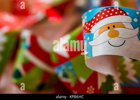 Paper decoration, Santa Claus, macro, selective focus. Christmas theme background, colorful wrapping paper with - Stock Photo