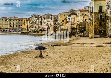 City of cefalu north of sicily sand sea and old constructions located at the foot of the beach island of sicily - Stock Photo