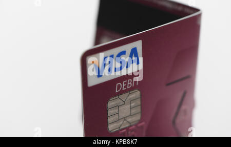 A folded Visa  debit card from Nat West on white background. - Stock Photo