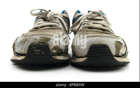 Isolated old sneaker shoes on a white background. - Stock Photo