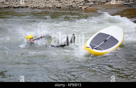 White water river surfing wipe out on Clear Creek River in Golden Colorado - Stock Photo