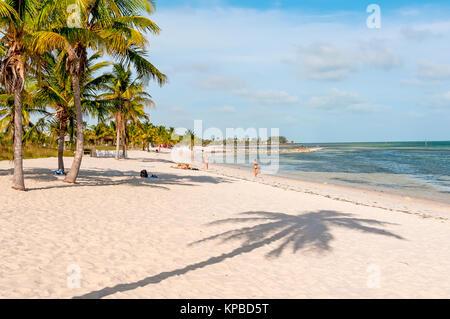 White sand Smathers Beach with palm trees, Key West, Florida - Stock Photo