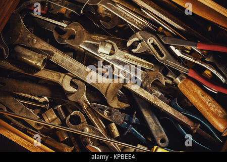 Closeup view of drawer full of old used tools. - Stock Photo