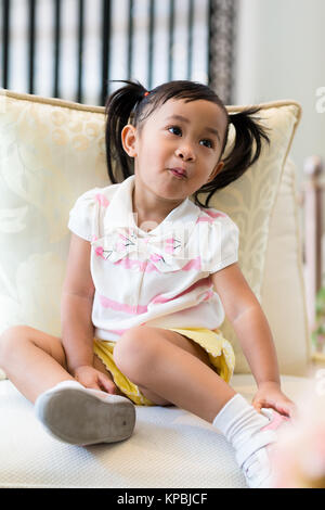 Toddler Girl In A Tiny Room Looking At Rabbit Stock Photo