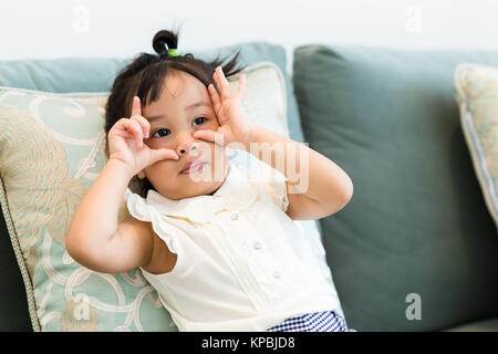 Adorable little girl making a funny face expression - Stock Photo