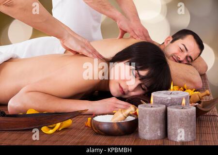 Beautiful Young Couple Enjoying Massage - Stock Photo