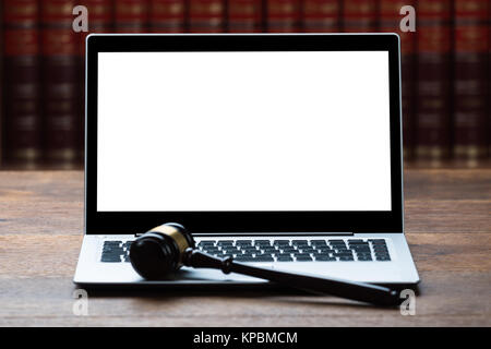 Laptop And Mallet On Table In Courtroom - Stock Photo