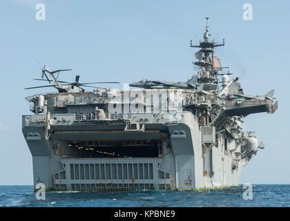 The U.S. Navy Wasp-class amphibious assault ship USS Makin Island steams underway December 11, 2014 in the Gulf - Stock Photo