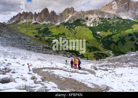 a group of climbers hiking down to the valley near Colfosco in the South Tyrol in the Dolomites after climbing a - Stock Photo