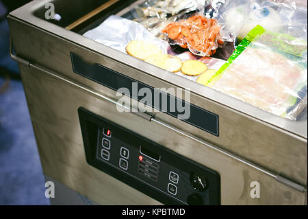 machines and mechanisms of production laboratories, vacuum packing of products - Stock Photo