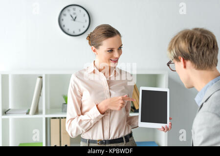 woman pointing on something on tablet - Stock Photo