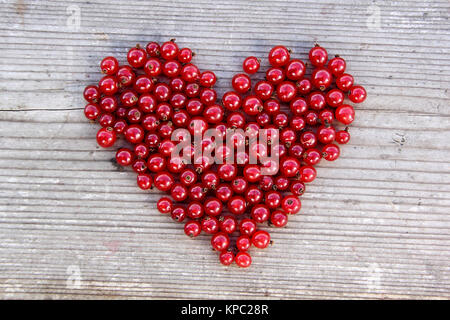 Heart shape from redcurrant. Love theme concept for Valentine's background and love theme. - Stock Photo