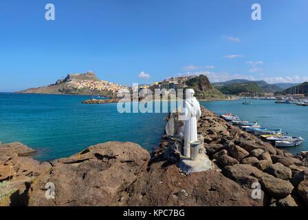 Sailor Patron saint figure at the harbour to Castelsardo, Sardinia, Italy, Mediterranean sea, Europe - Stock Photo