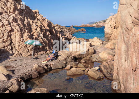 Idyllic bathing beach at rocky coast of Costa Paradiso, Porphyry rocks, Sardinia, Italy, Mediterranean  sea, Europe - Stock Photo